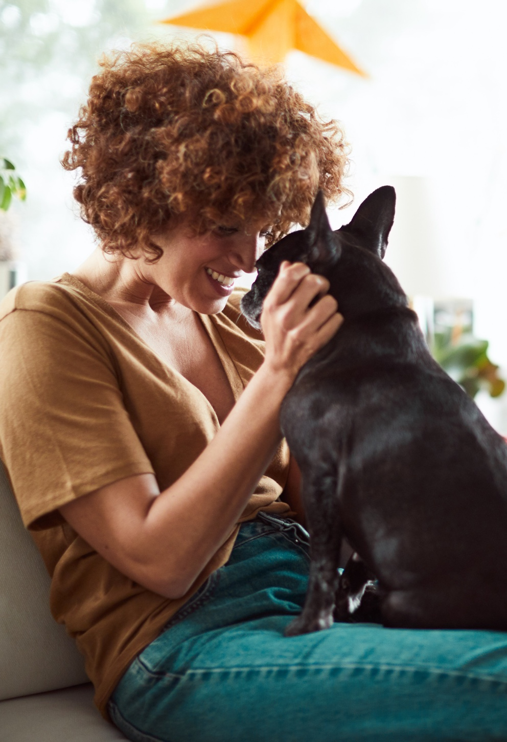 woman petting dog